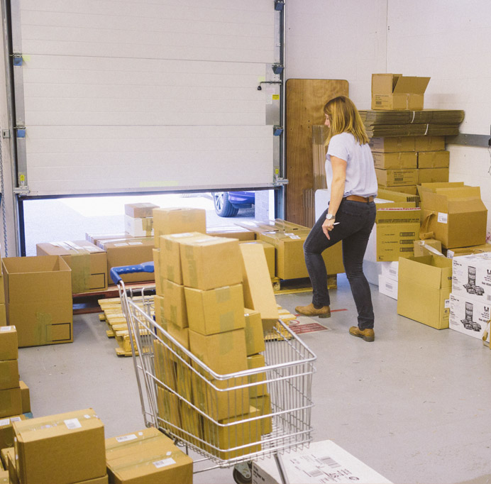 woman-moving-boxes-in-workshop