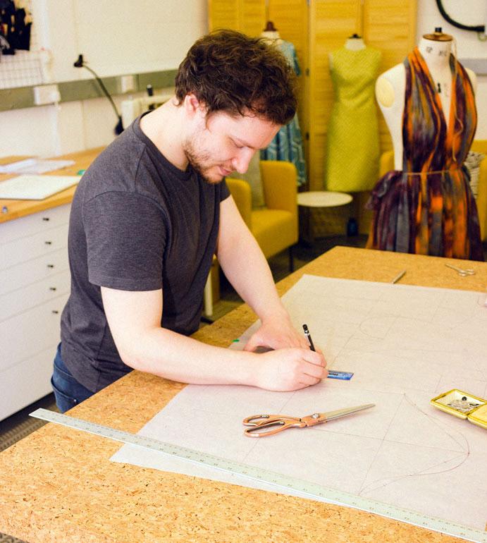 man-drawing-dress-pattern